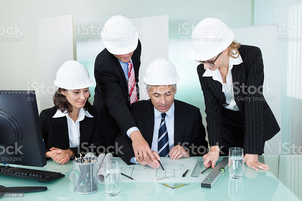 Meeting of architects or structural engineers stock photo