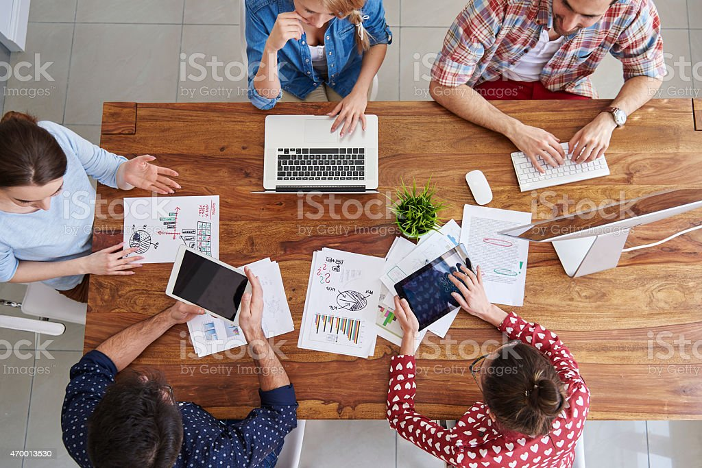 Meeting of coworkers and planning next steps of work stock photo