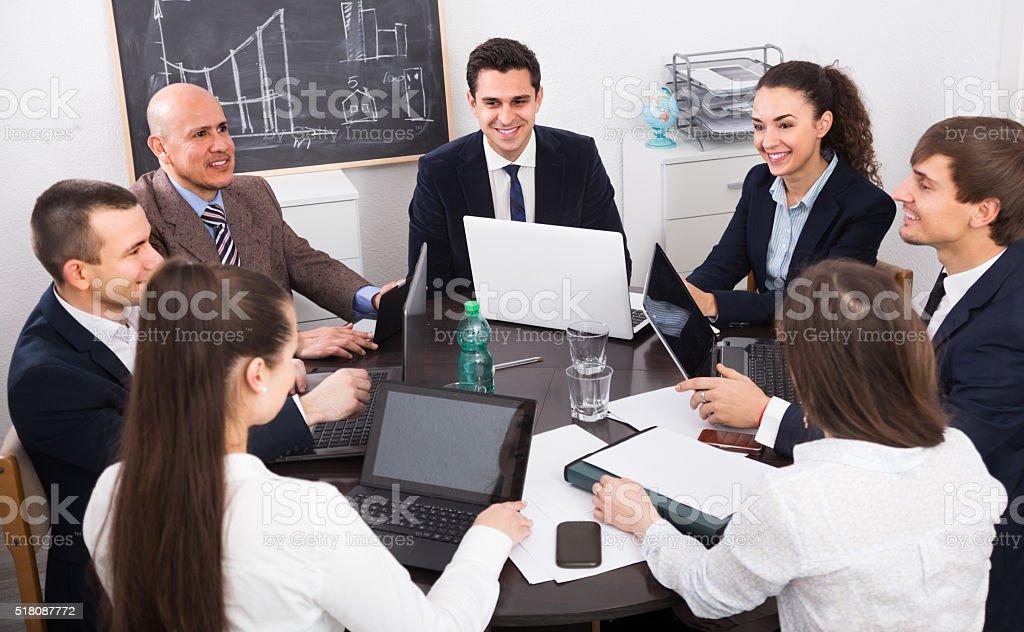 meeting of multinational team stock photo
