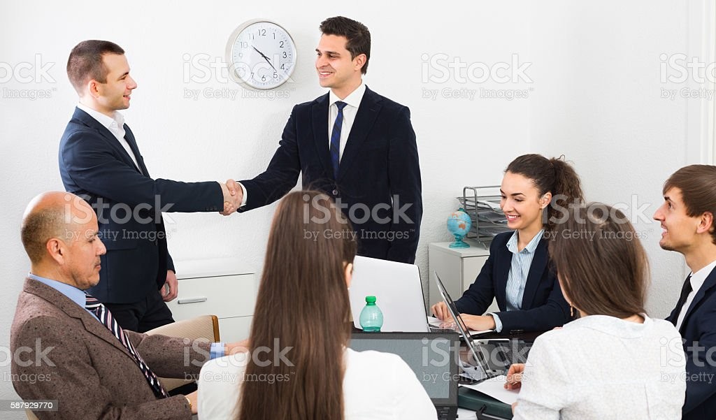 meeting of multinational team stock photo