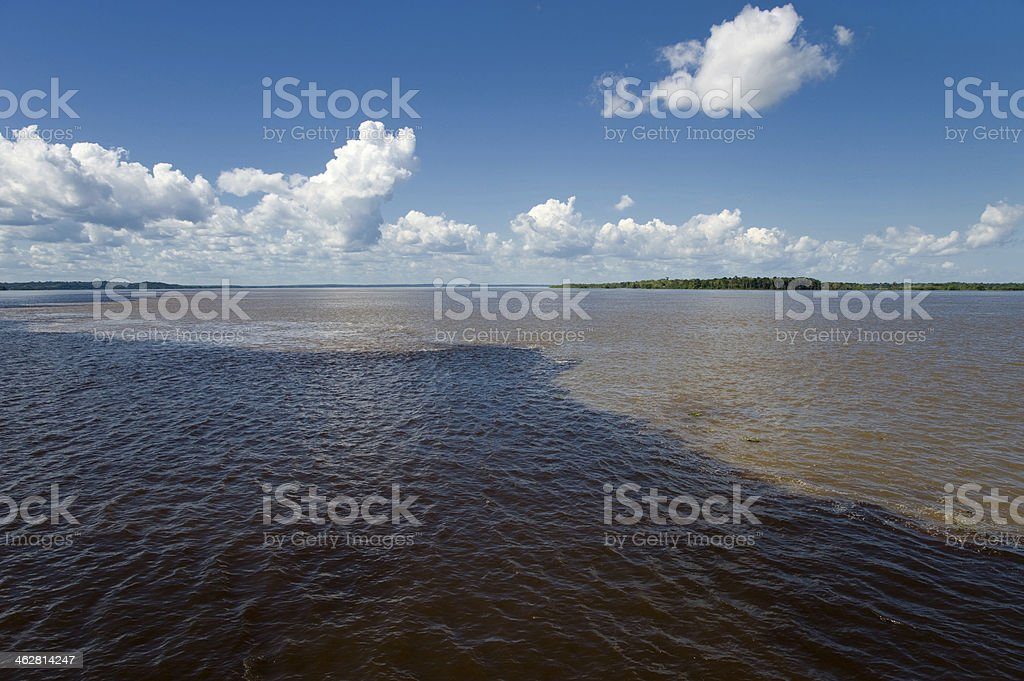 Meeting of Waters in the Amazon rainforest, Brazil stock photo