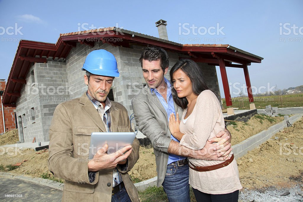 Meeting on construction site to check details with entrepreneur royalty-free stock photo