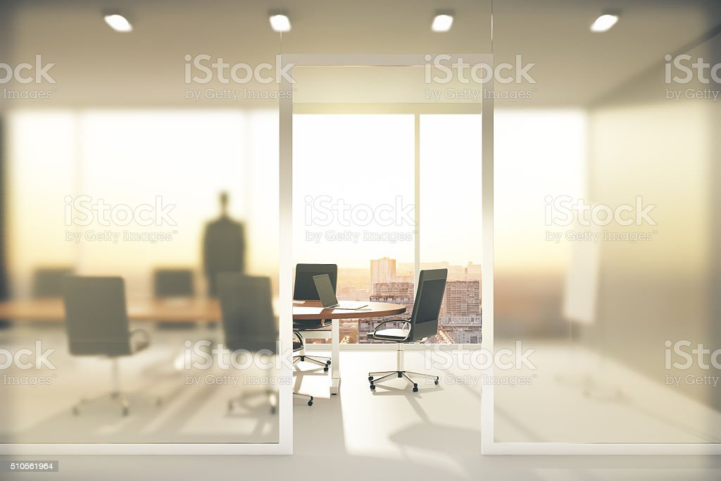 Meeting room with frosted glass walls stock photo