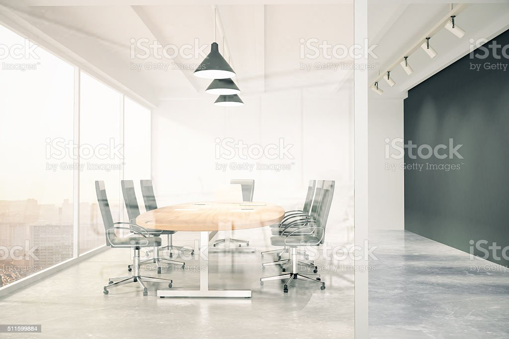 Meeting room with glass wall, blackboard, wooden table, window a stock photo