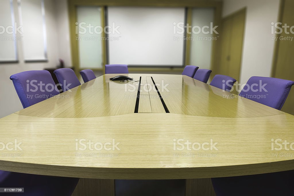 Meeting room with wooden table stock photo