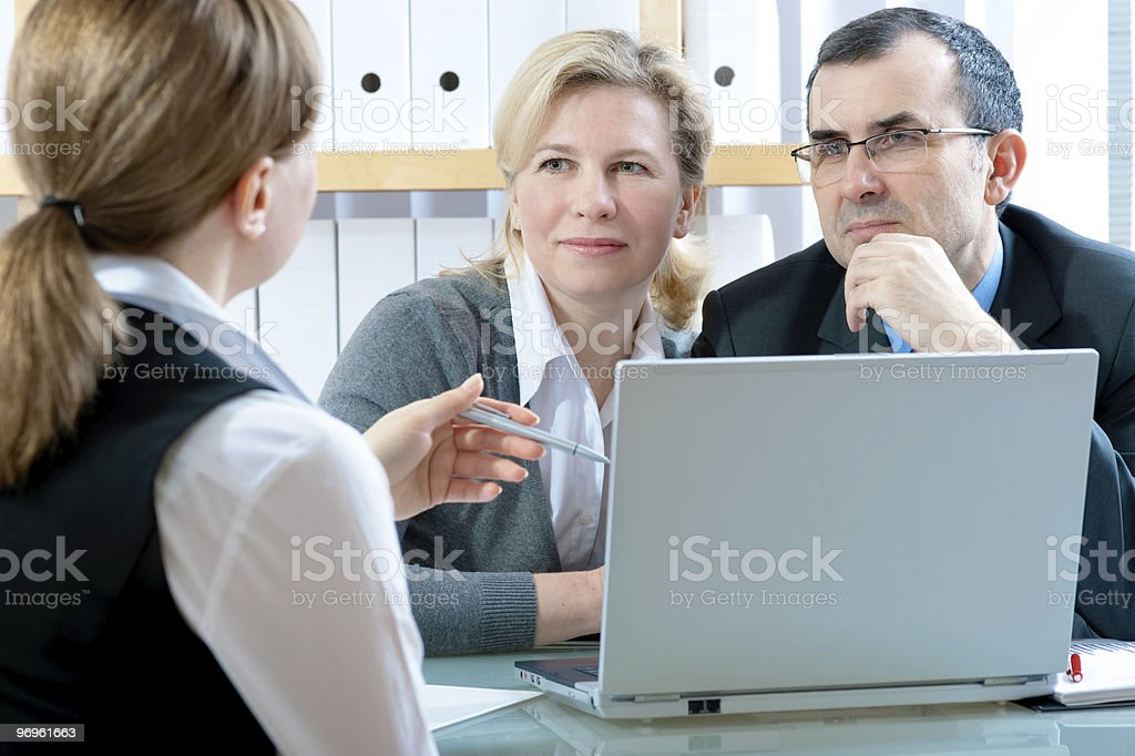 Meeting with laptop and three business people stock photo