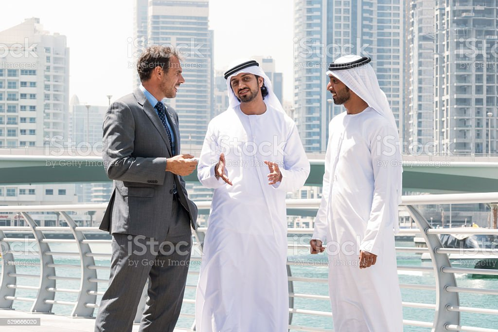 Meeting with Middle eastern businessmen and western man stock photo