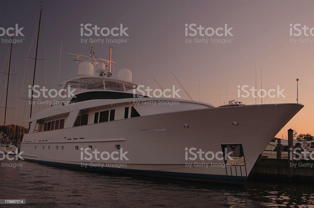 Mega yacht at dusk royalty-free stock photo