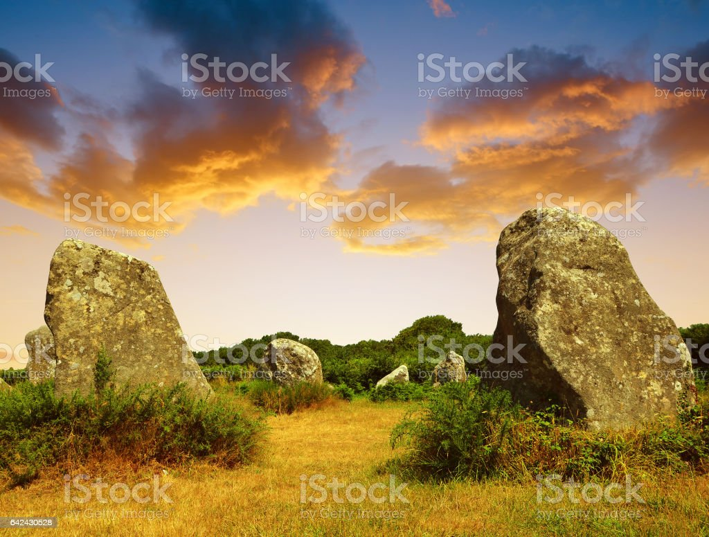 Megalithic monuments menhirs in Carnac at sunset stock photo