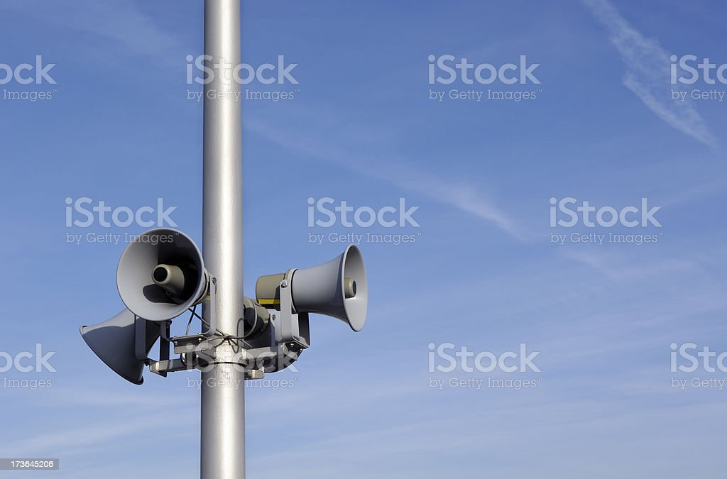 Megaphones and blue sky royalty-free stock photo