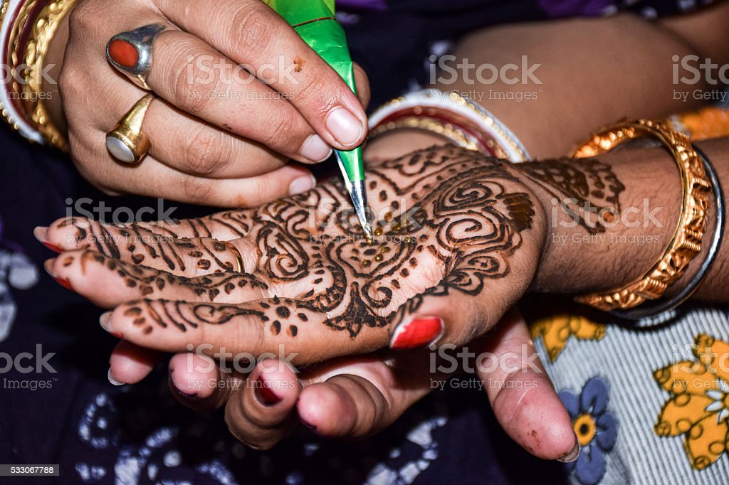 Mehendi on a bride's hand stock photo