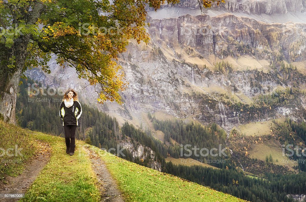 Melancholic Autumn walk in the Swiss Alps stock photo
