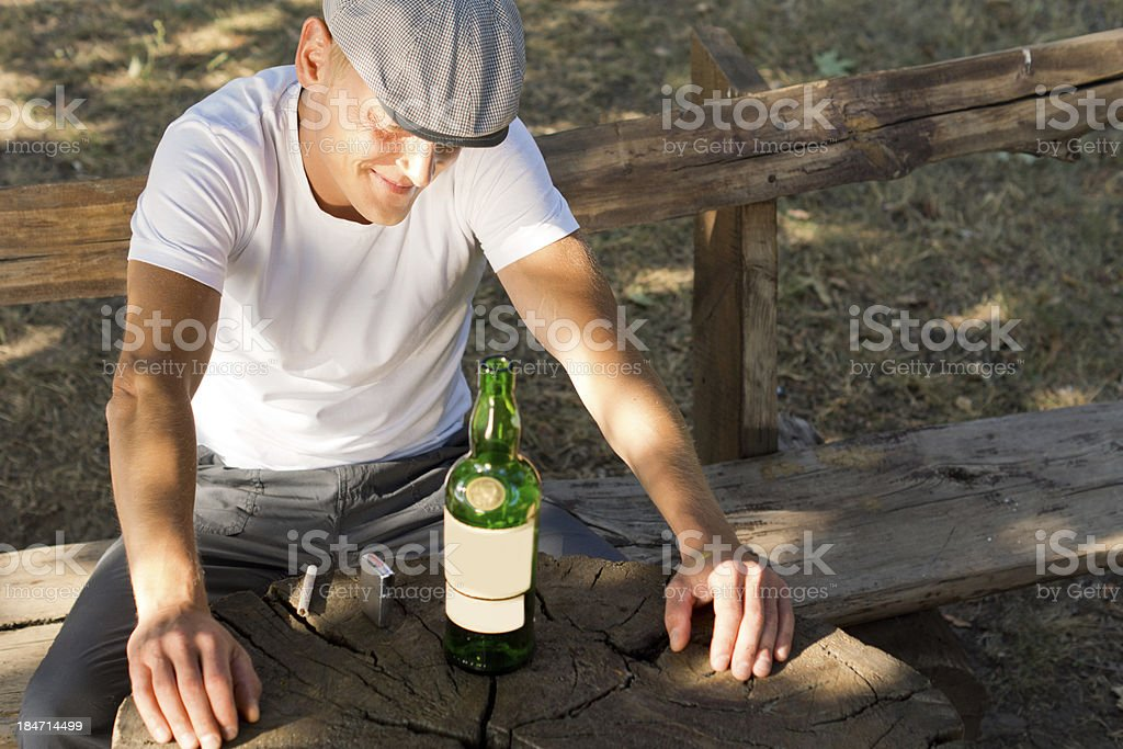 Melancholic drunk man with a bottle of white wine royalty-free stock photo