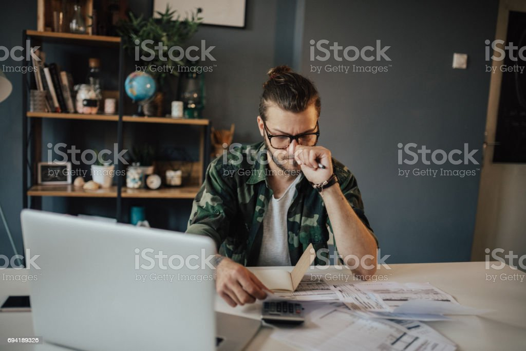 Melancholic man having problems with household expenses