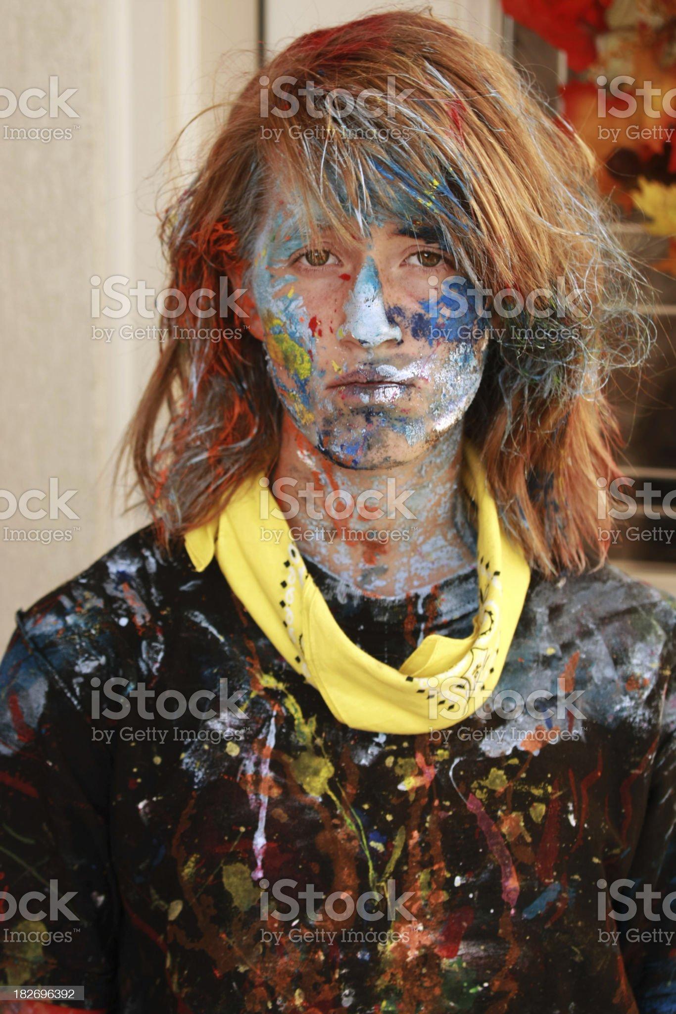Melancholy Face of Teenage Painter royalty-free stock photo