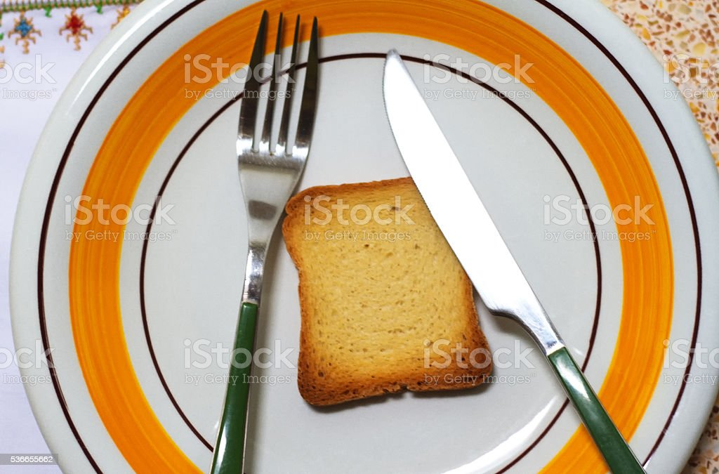 Melba Toast on Vintage Dinner Plate with Fork and Knife stock photo