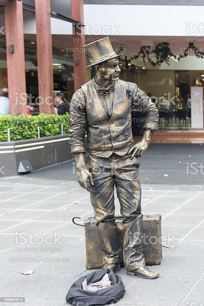 Melbourne Busker - Living statue entertaining tourists stock photo