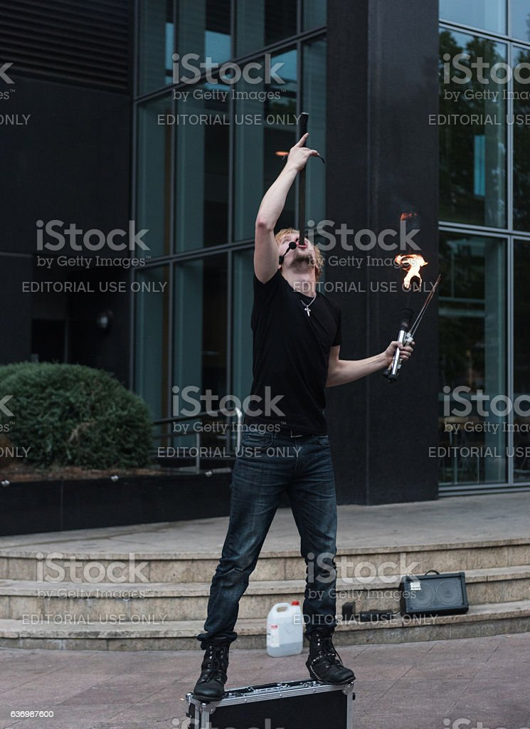 Melbourne Busker - Sword Swallower entertaining tourists stock photo