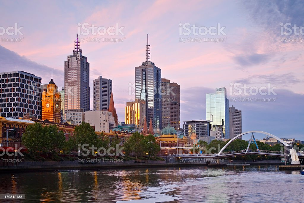 Melbourne skyline at sunset by a river royalty-free stock photo