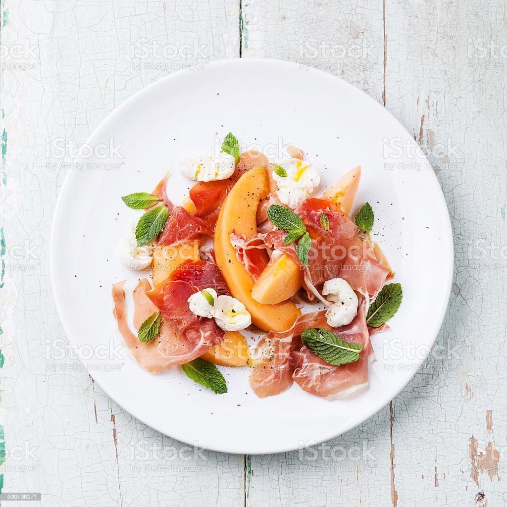 Melon and prosciutto ham salad stock photo