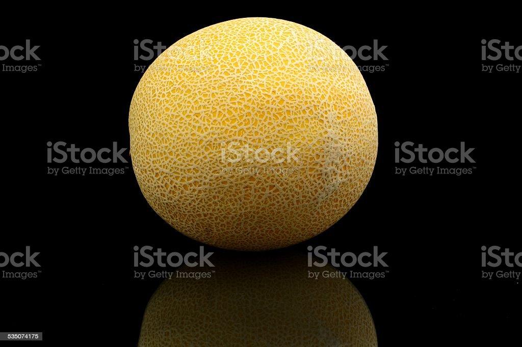Melon called galia isolated black in studio stock photo