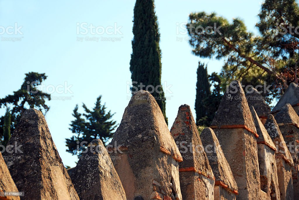 Melon on a Fortfied wall surround by cypress trees. stock photo