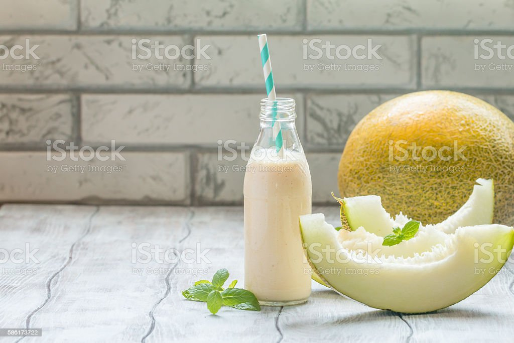 melon smoothie in a glass bottle stock photo