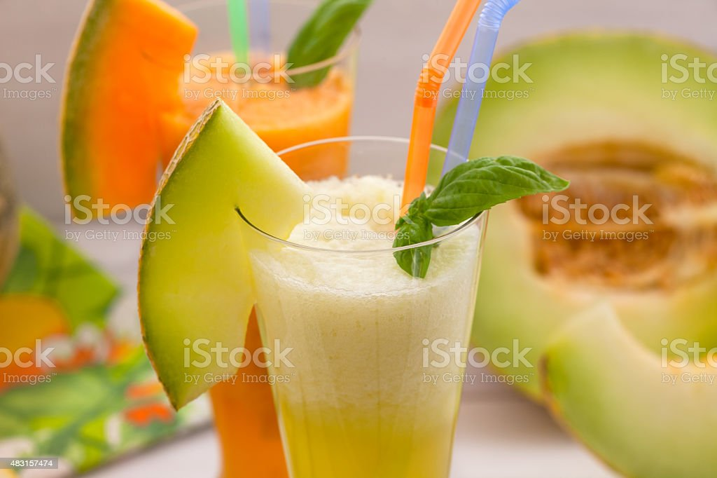 Melon with mint leaves stock photo