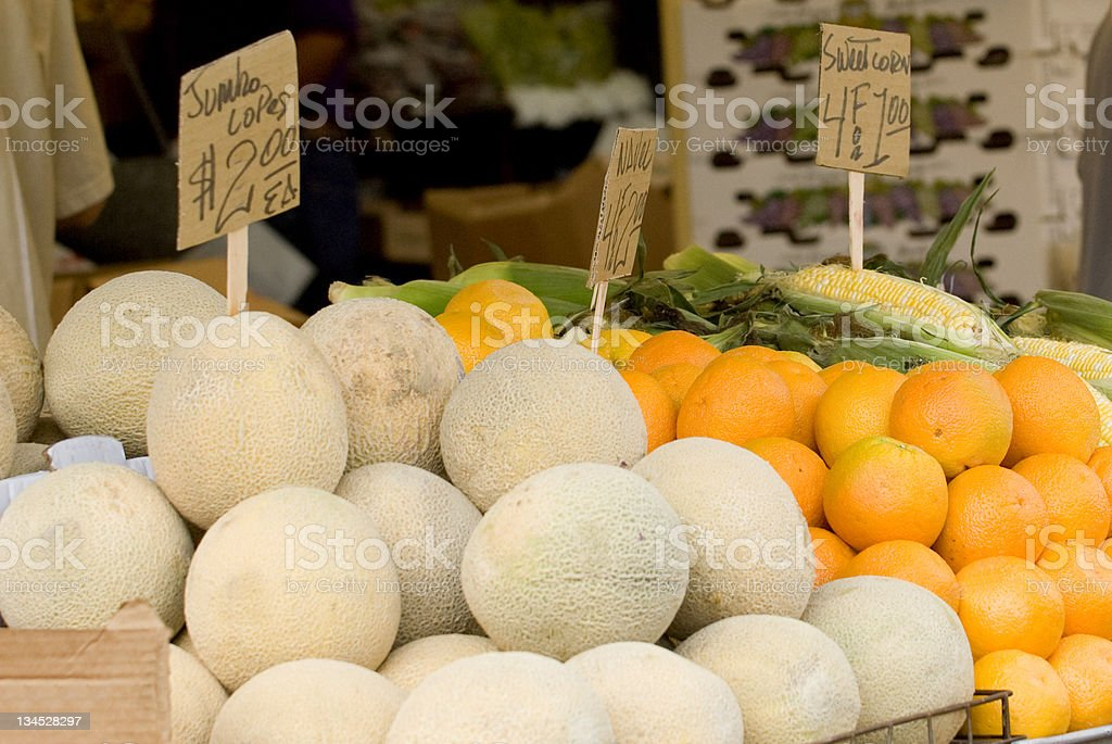 Melons, Oranges, and Sweetcorn at Farmers Market stock photo