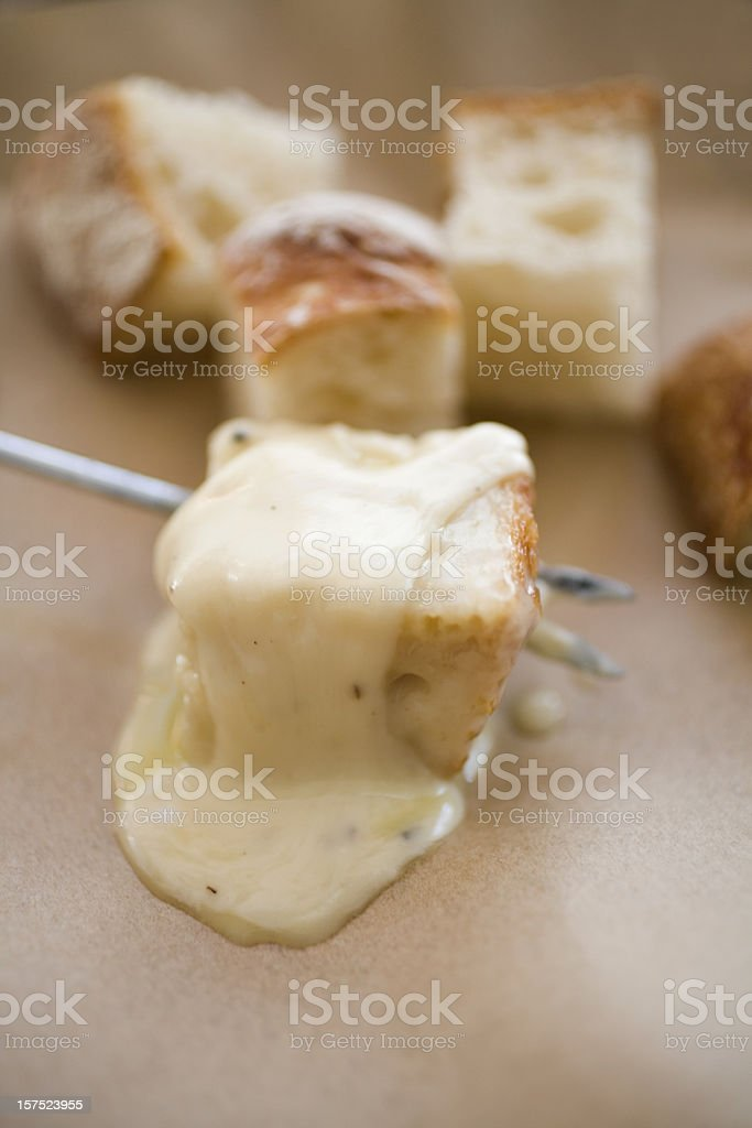 Melted cheese fondue stock photo