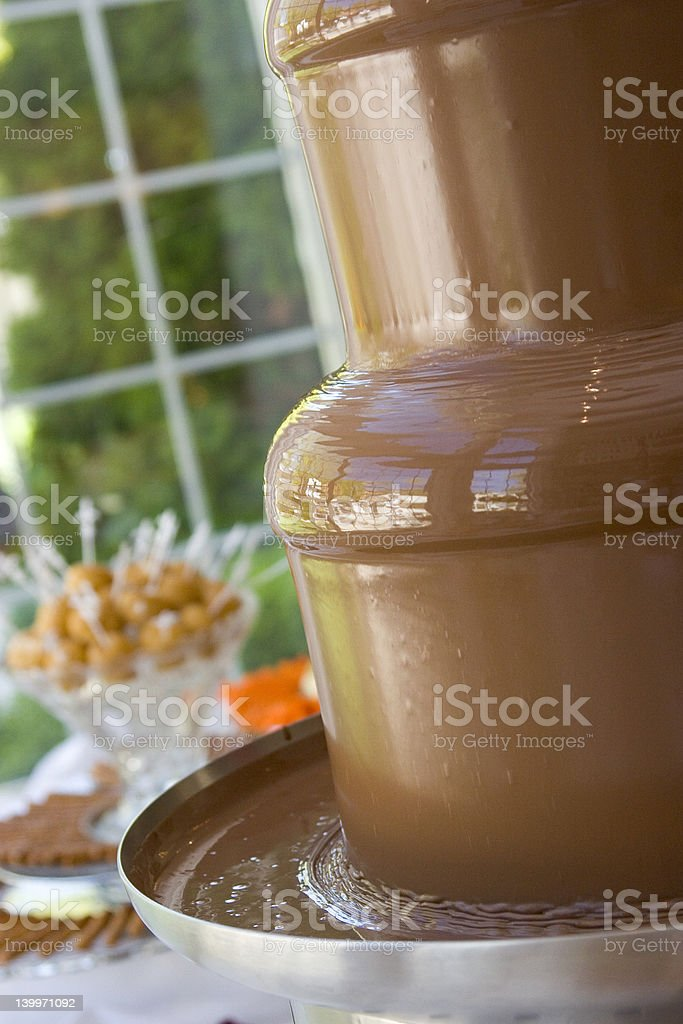 Melted Chocolate Fondue Fountain royalty-free stock photo