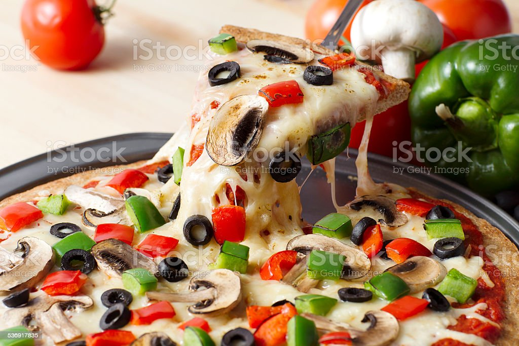 melted pizza on the pan stock photo
