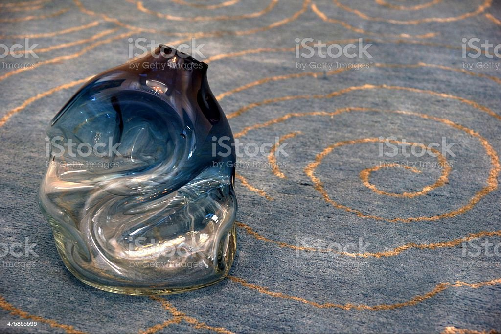 Melted Vase on Swirl Rug stock photo
