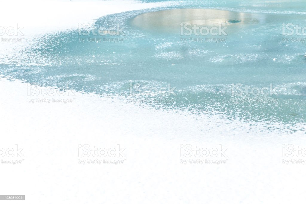 Melted water puddle stock photo