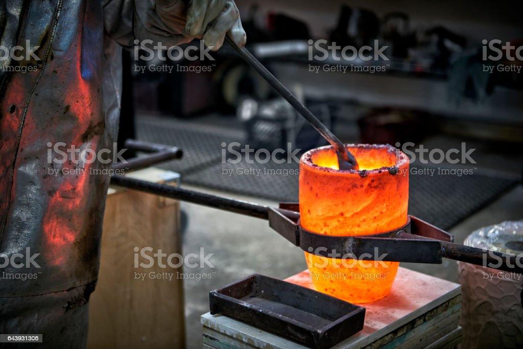 Melting bronze for casting a bronze scuplture stock photo