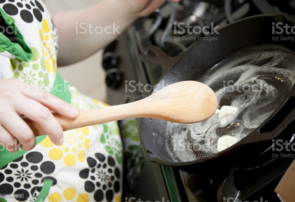Melting butter in a frying pan royalty-free stock photo