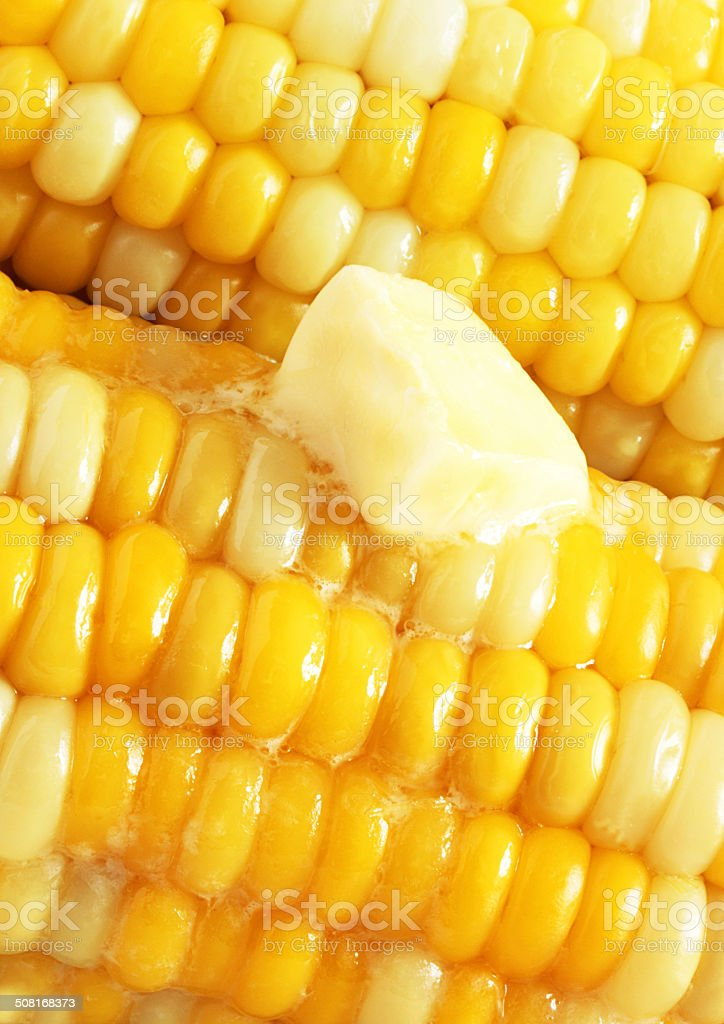 Melting butter on corn on the cob stock photo