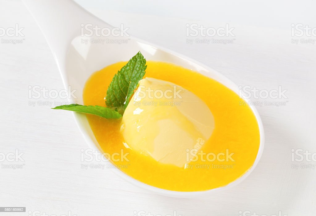 melting butter on spoon stock photo