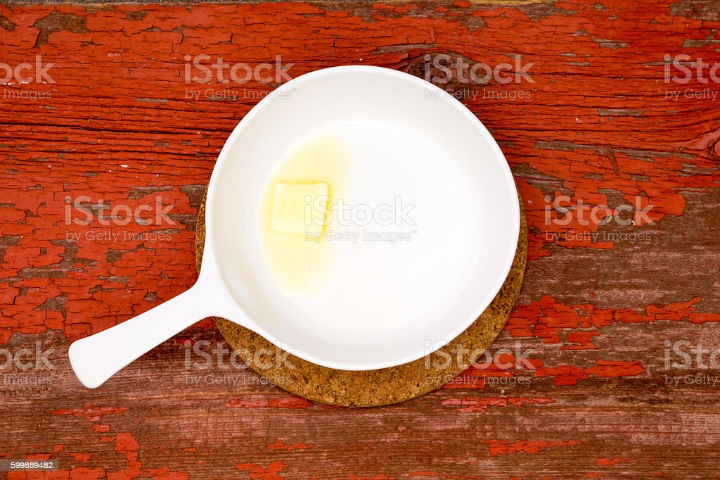 Melting Butter on White Serving Plate with handle stock photo