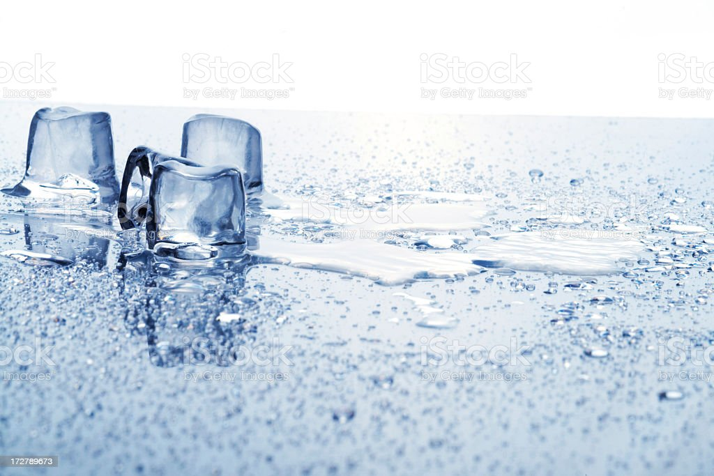 Melting ice cubes on watery table royalty-free stock photo