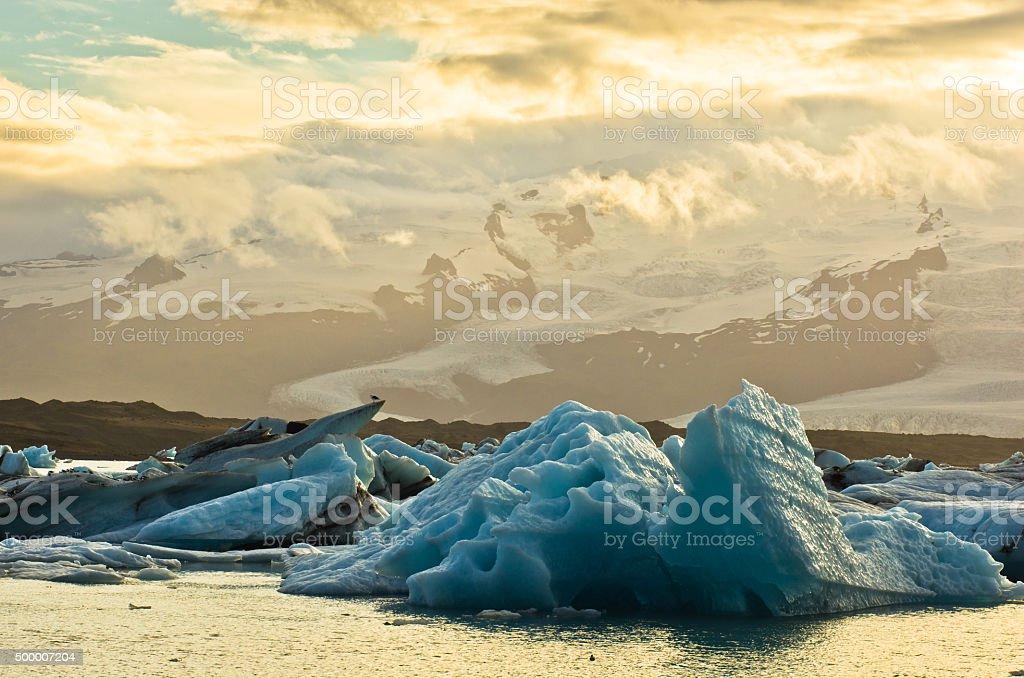 Melting of icebergs in Jokulsarlon glacier lagoon at sunset stock photo