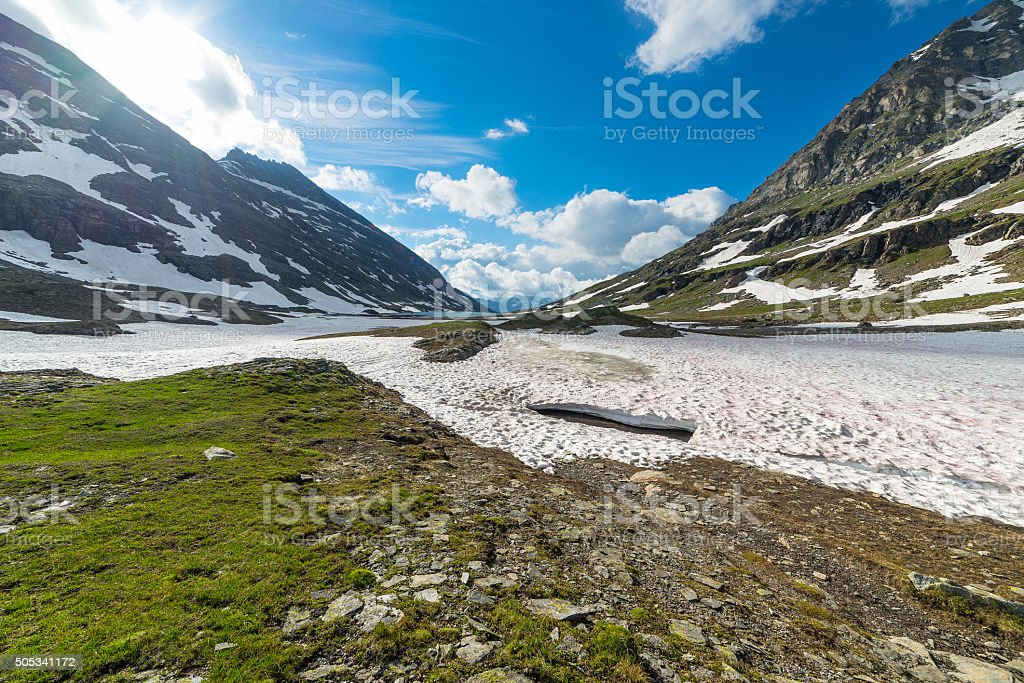 Melting snow at high altitude in the Alps stock photo