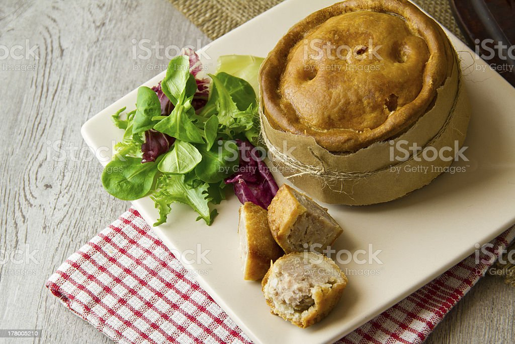 Melton Mowbray pork pies on plate royalty-free stock photo
