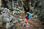 Member of canyoning team moving through the canyon