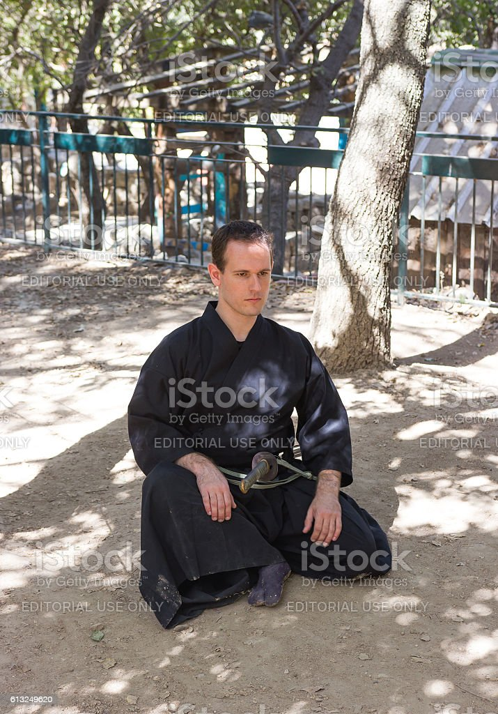 Member of festival 'Knights of Jerusalem', shows exercise with s stock photo
