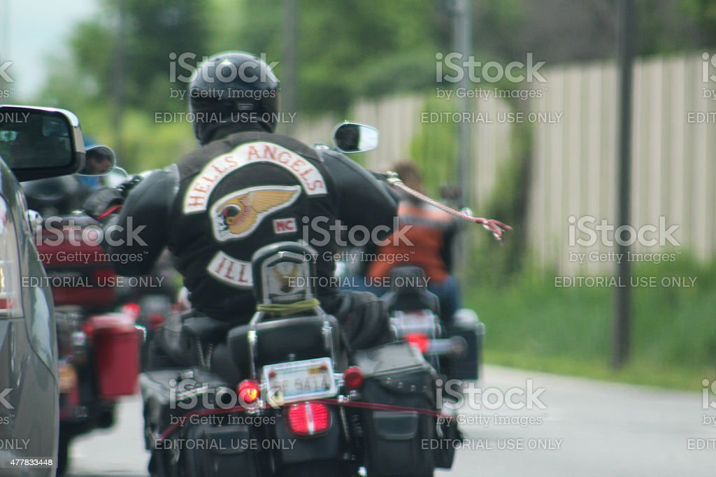Member of Hell's Angels Gang Crowds SUV on Interstate 294 stock photo