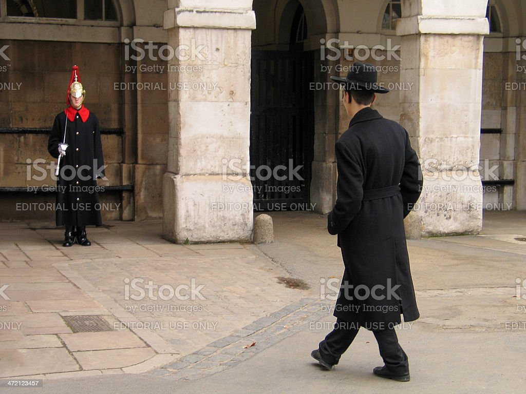 Member of Household Cavalry on duty and jewish orthodox visitor royalty-free stock photo