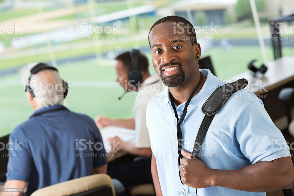 Member of media arriving in press box to report game stock photo