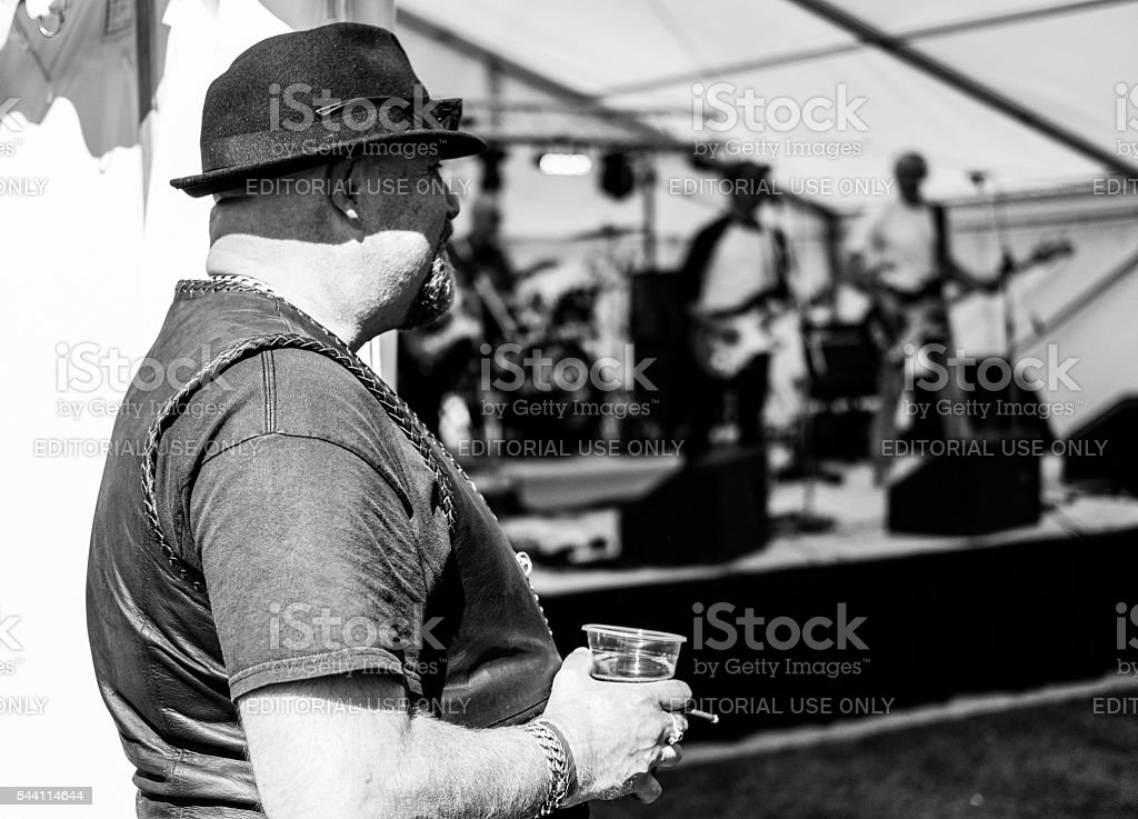 Member of the public listening to a rock band stock photo
