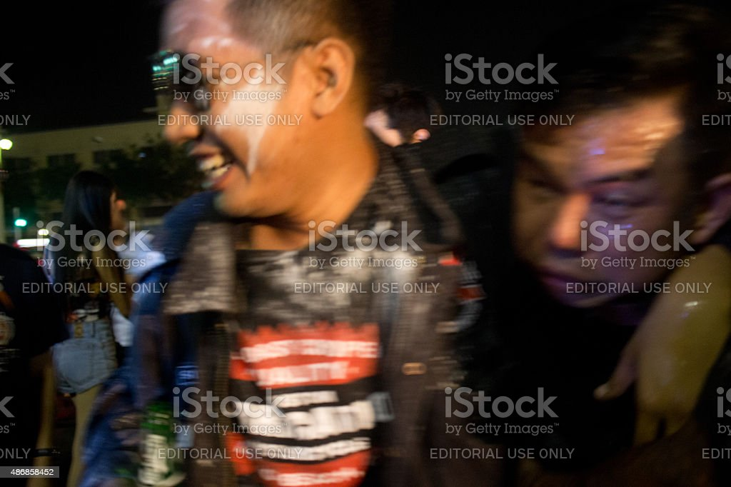 Members of a Bangkok Motorcycle Rally Cavort and Party stock photo